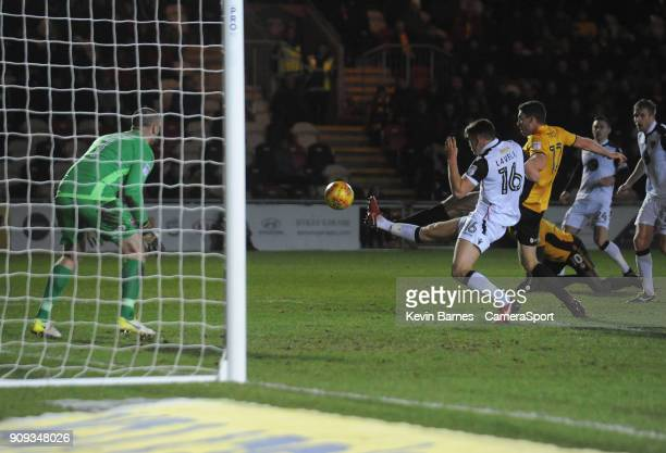 Newport County's Ben Tozer scores the opening goal during the Sky Bet League Two match between Newport County and Morecambe at Rodney Parade on...