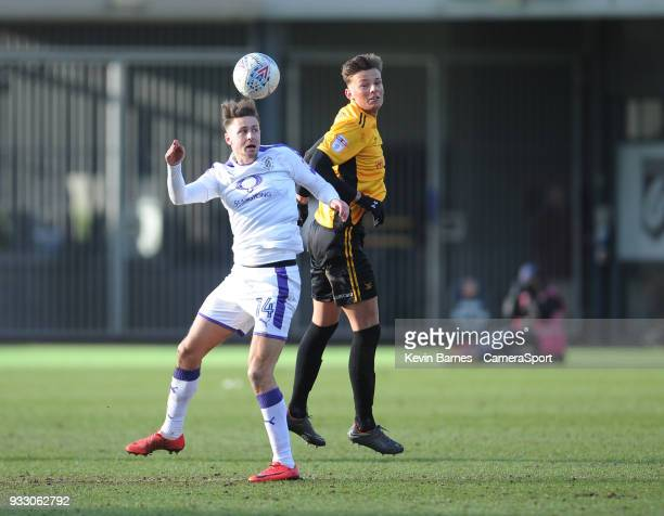 Newport County's Ben White vies for possession with Luton Town's Harry Cornick during the Sky Bet League Two match betweenNewport County and Luton...