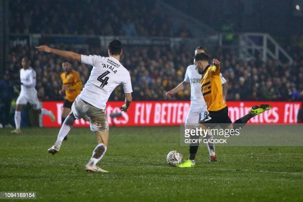 Newport County's English midfielder Robbie Willmott scores the opening goal during the English FA Cup fourth round replay football match between...