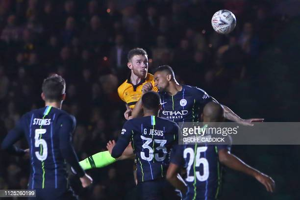 Newport County's Irish defender Mark O'Brien has this header saved during the English FA Cup fifth round football match between Newport County and...