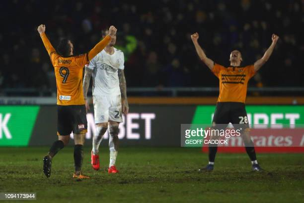 Newport County's Irish striker Padraig Amond and Newport County's English defender Mickey Demetriou celebrates at the final whistle during the...