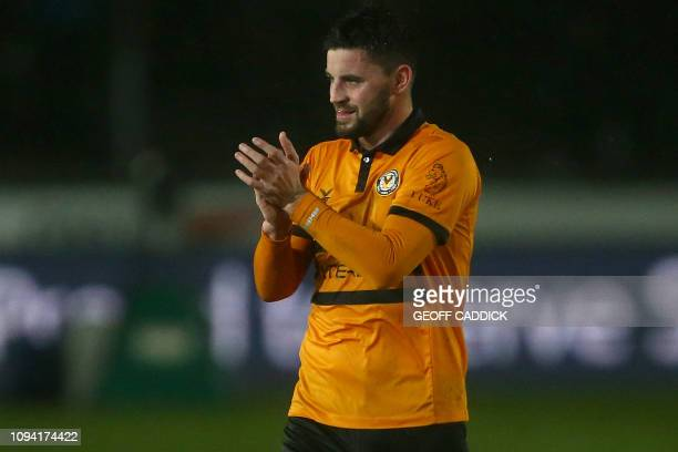 Newport County's Irish striker Padraig Amond applauds the fans following the English FA Cup fourth round replay football match between Newport County...