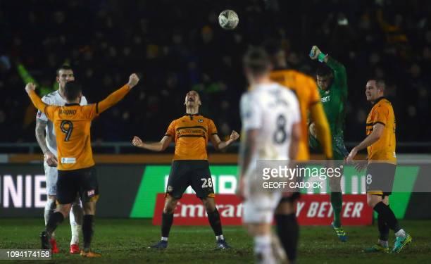 Newport County's Irish striker Padraig Amond , Newport County's English defender Mickey Demetriou , Newport County's English goalkeeper Joe Day and...