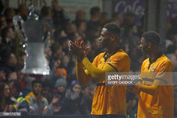 Newport County's Jamaican striker Jamille Matt and Newport County's English midfielder Tyreeq Bakinson applaud the fans following the English FA Cup...