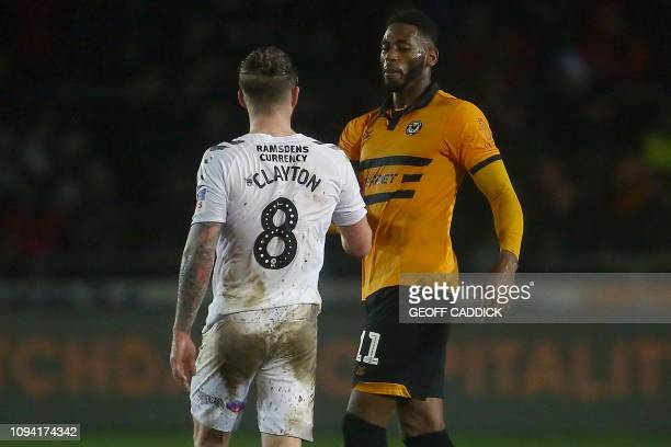 Newport County's Jamaican striker Jamille Matt shakes hands with Middlesbrough's English midfielder Adam Clayton after the English FA Cup fourth...
