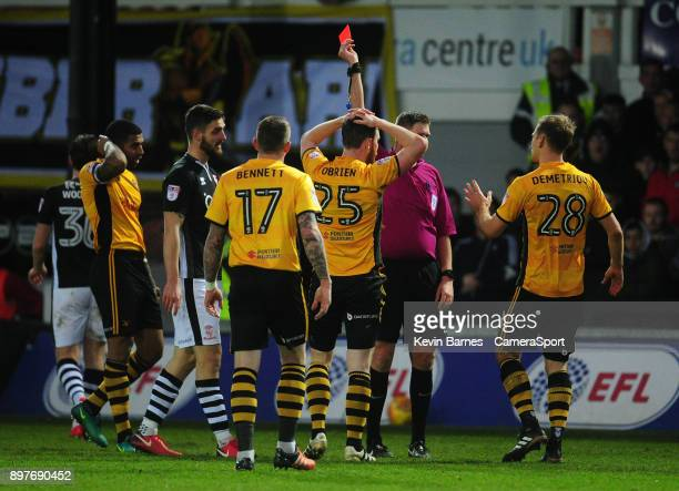 Newport County's Mark O'Brien is shown a red card by Referee Brett Huxtabl during the Sky Bet League Two match between Newport County and Lincoln...