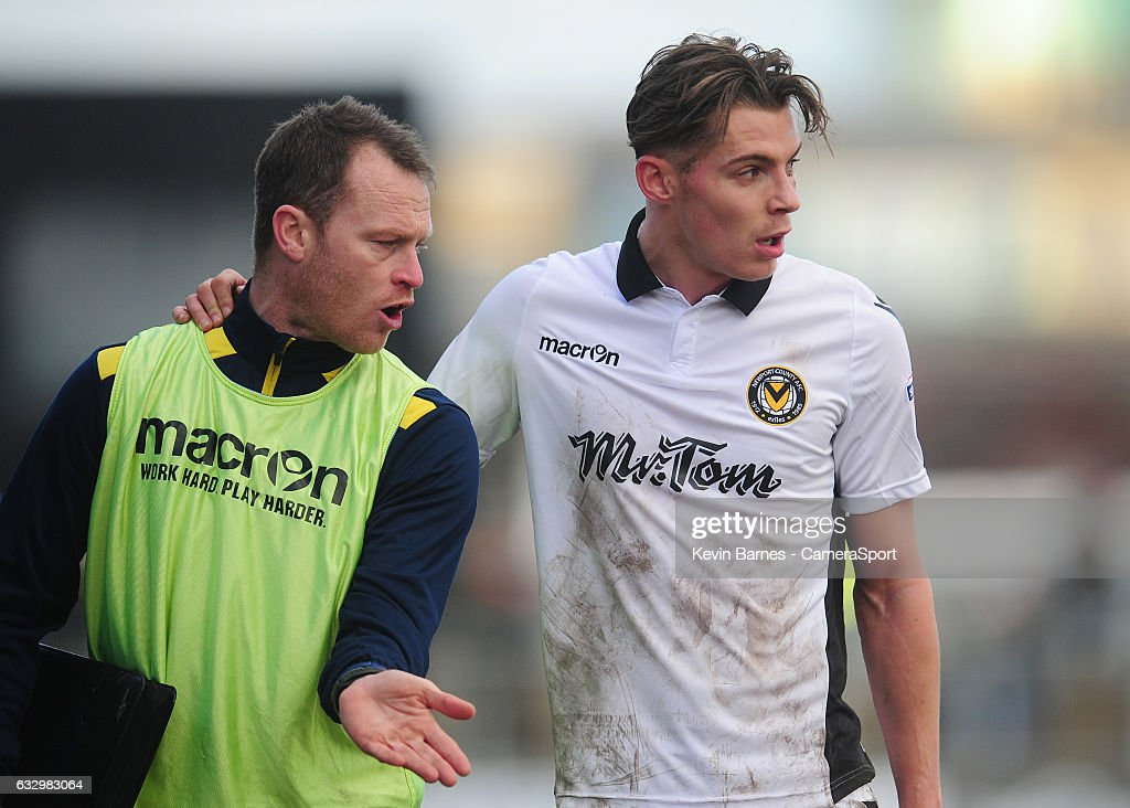Newport County's Michael Flynn chats with Sid Nelson at half time during the Sky Bet League Two match between Newport County and Hartlepool United at Rodney Parade on January 28, 2017 in Newport, Wales.