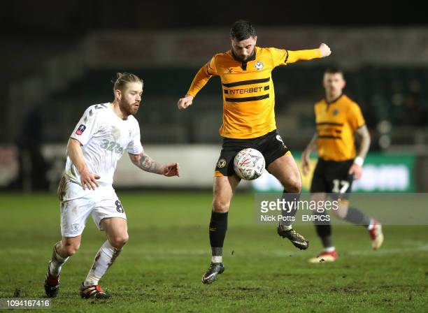 Newport County's Padraig Amond and Middlesbrough's Adam Clayton battle for the ball Newport County v Middlesbrough FA Cup Fourth Round Replay Rodney...