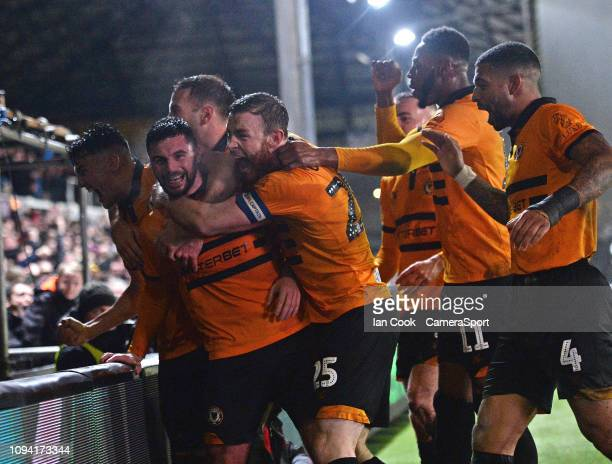 Newport County's Padraig Amond celebrates scoring his side's second goal with his team mates during the FA Cup Fourth Round Replay match between...