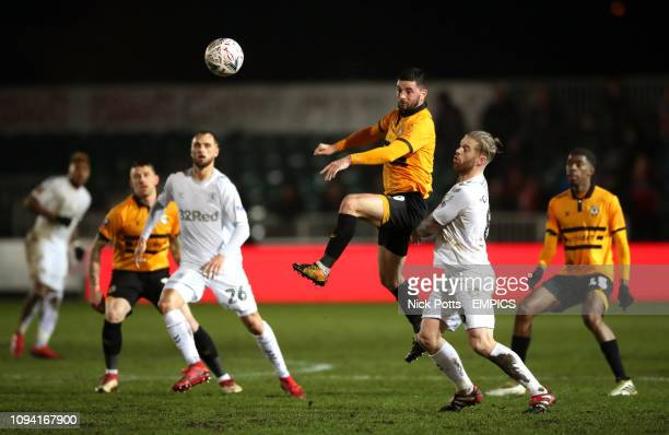 Newport County's Padraig Amond heads the ball away from Middlesbrough's Adam Clayton Newport County v Middlesbrough FA Cup Fourth Round Replay Rodney...