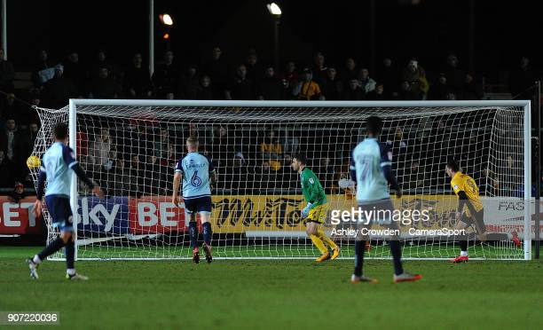 GOAL Newport County's Padraig Amond scores the opening goal during the Sky Bet League Two match between Newport County and Crawley Town at Rodney...