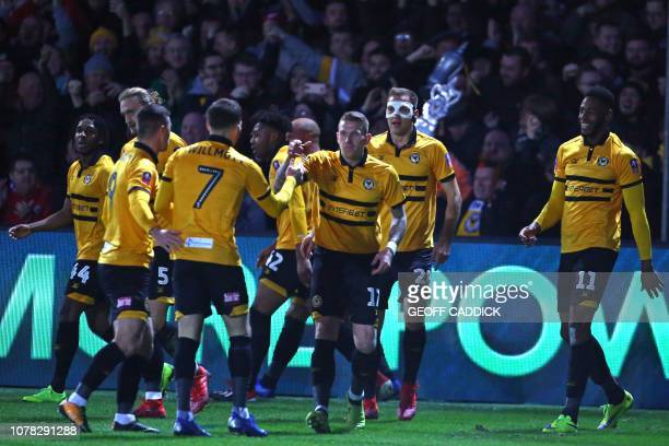 Newport County's players celebrate after Jamaican striker Jamille Matt scores the opening goal of the English FA Cup third round football match...