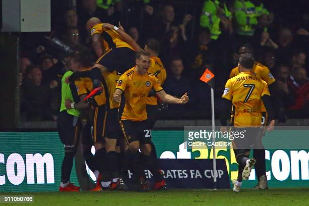 Newport County's players celebrate Padraig Amond's first half goal during the English FA Cup fourth round football match between Newport County and...