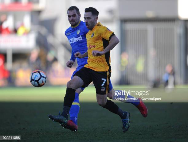 Newport County's Robbie Willmott vies for possession with Leeds United's PierreMichel Lasogga during the Emirates FA Cup Third Round match between...