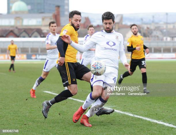 Newport County's Robbie Willmott vies for possession with Luton Town's Alan Sheehan during the Sky Bet League Two match betweenNewport County and...