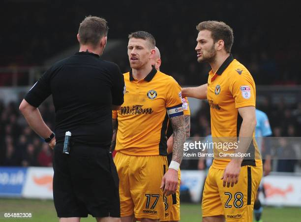Newport County's Scot Bennett and Mickey Demetriou protest the awarding of a penalty after a foul on Blackpool's Bright OsayiSamuel during the Sky...