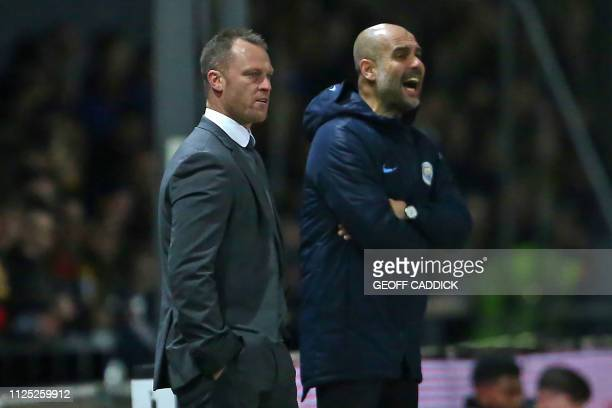 Newport County's Welsh manager Michael Flynn and Manchester City's Spanish manager Pep Guardiola watch from the touchline during the English FA Cup...