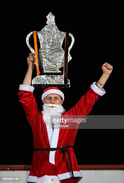 Newport fan poses with a homemade FA Cup whilst dressed as Father Christmas during The Emirates FA Cup Second Round Replay between Newport County and...