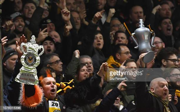 Newport fans celebrate the winning goal during the FA Cup Third Round match between Newport County and Leicester City at Rodney Parade on January 6,...