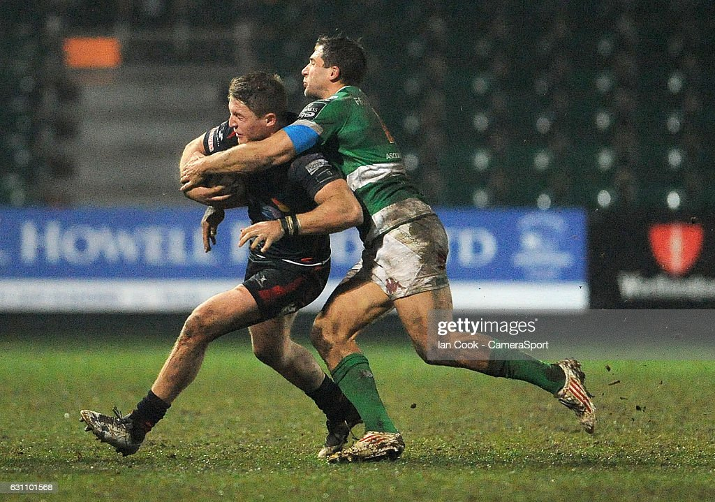 Newport Gwent Dragons' Tyler Morgan is tackled by Benetton Treviso's Alberto Sgarbi during the Guinness PRO12 Round 13 match between Newport Gwent Dragons and Benetton Rugby Treviso at Rodney Parade on January 6, 2017 in Newport, Wales.
