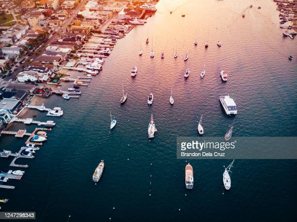 newport harbor sunset - newport beach california stock pictures, royalty-free photos & images
