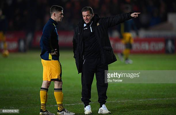Newport manager Graham Westley talks to player Rhys Healey before The Emirates FA Cup Second Round Replay between Newport County and Plymouth Argyle...