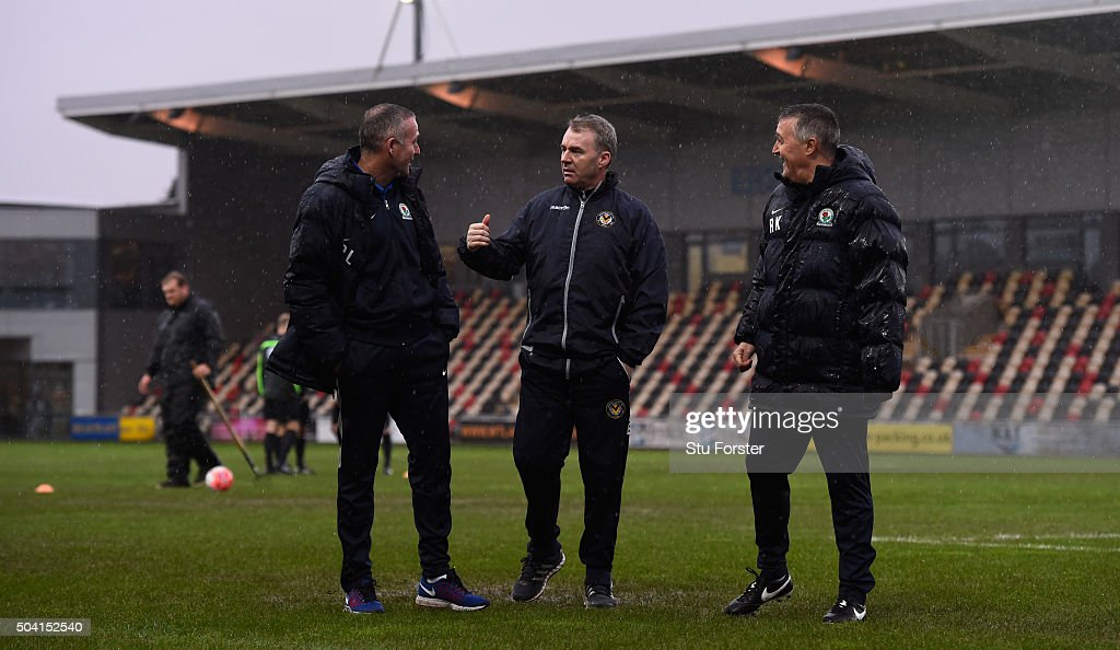 Newport manager John Sheridan (c) discusses the possibilities of play on a waterlogged pitch with Blackburn manager Paul Lambert (l) and coach Mike Kelly before The Emirates FA Cup Third Round match between Newport County AFC and Blackburn Rovers at Rodney Parade on January 9, 2016 in Newport, Wales.
