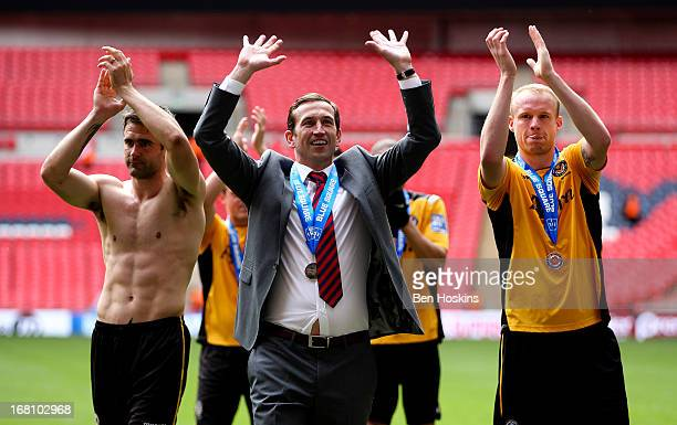 Newport manager Justin Edinburgh celebrates with his players during the Blue Square Bet Premier Conference Playoff Final match between Wrexham and...