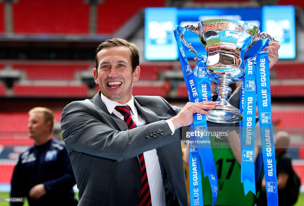 Newport manager Justin Edinburgh celebrates with the trophy after the Blue Square Bet Premier Conference Play-off Final match between Wrexham and Newport County A.F.C at Wembley Stadium on May 05, 2013 in London, England.
