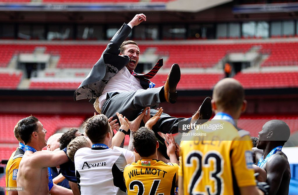 Newport manager Justin Edinburgh is thrown in the air by his after the Blue Square Bet Premier Conference Play-off Final match between Wrexham and Newport County A.F.C at Wembley Stadium on May 05, 2013 in London, England.