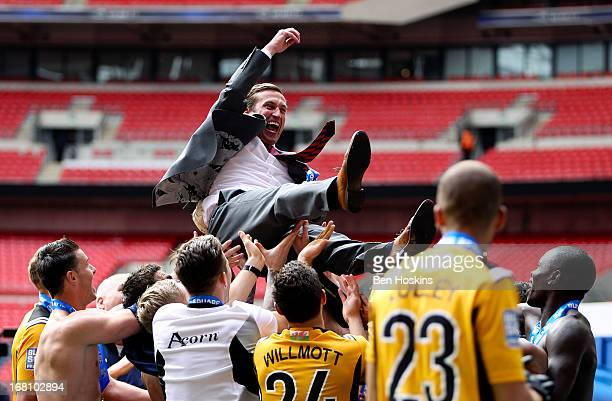 Newport manager Justin Edinburgh is thrown in the air by his after the Blue Square Bet Premier Conference Play-off Final match between Wrexham and...