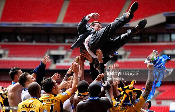 Newport manager Justin Edinburgh is thrown in the air by his players after the Blue Square Bet Premier Conference Playoff Final match between Wrexham...