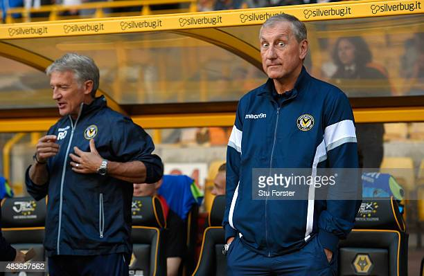 Newport manager Terry Butcher 'gives the eyes' as assistant Russell Osman looks on before the Capital One Cup First Round match between Wolverhampton...