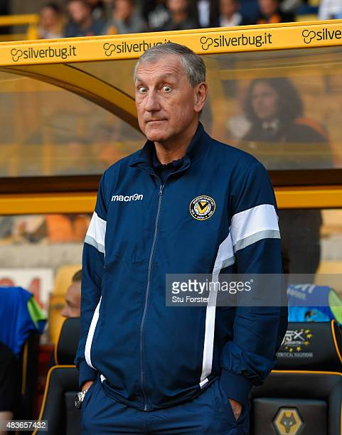 Newport manager Terry Butcher 'gives the eyes' before the Capital One Cup First Round match between Wolverhampton Wanderers and Newport County at...