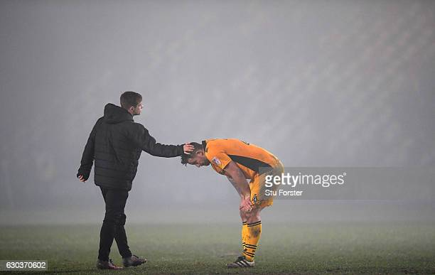 Newport player Darren Jones is consoled on the final whistle after loosing in extra time during The Emirates FA Cup Second Round Replay between...