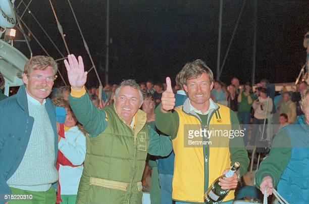 Americas Cup Yacht Races Alan Bond and John Bertrand of Australia wave and give 'thumbsup' sign after defeating the United States in the America's Cup