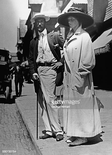Newport, R.I.-: John Jacob Astor IV, 1864-1912, standing with his wife, the former Madeleine Force. He died on the Titantic; she survived him and...
