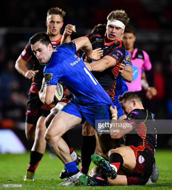 Newport , United Kingdom - 1 December 2018; Conor O'Brien of Leinster is tackled by Hallam Amos and Aaron Wainwright of Dragons during the Guinness...
