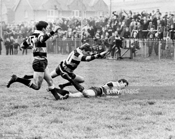Newport winger Stuart Watkins pouncing for his 100th try for Newport to help beat Cardiff at Rodney Parade, 11th November 1968.