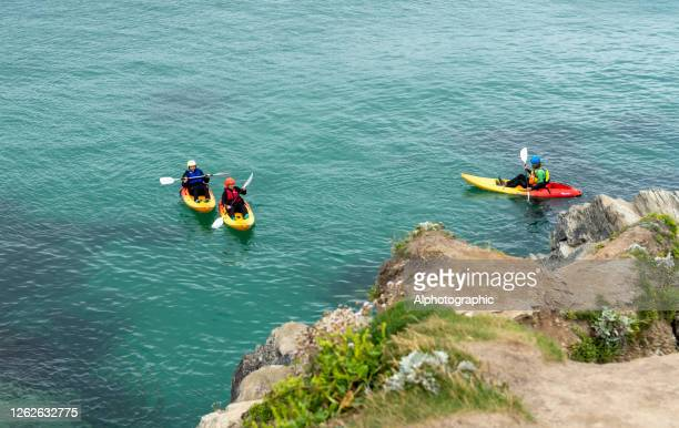 newquay bay - sea kayaking stock pictures, royalty-free photos & images