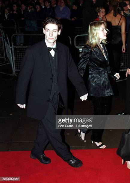 PA News 27/10/98 Actor Dean Gaffney arrives with his girlfriend at the Royal Albert Hall in London for the National Television Awards