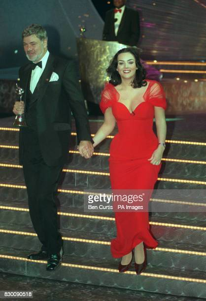 News 27/10/98 Television presenter Matthew Kelly and 'Eastenders' actress Martine McCutcheon leave the stage National Television Awards in the Royal...