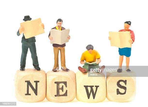 news abstract with figurines