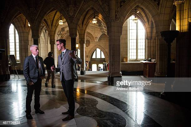 News anchor Anderson Cooper speaks with Josh Wingrove a reporter with The Globe and Mail in the central rotunda of the Canadian Parliament one day...