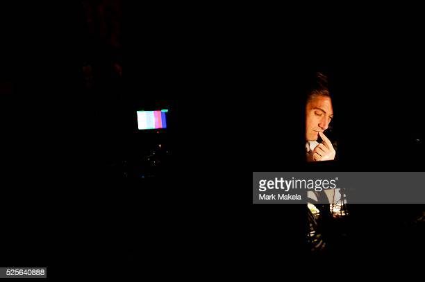 ABC News anchor David Muir works in a temporary auditorium balcony television set several hours before the Vice Presidential debate between Joe Biden...