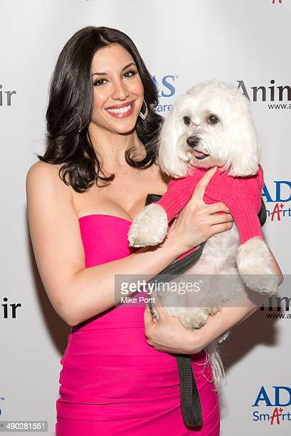 News Anchor Diana Falzone with dog Baily attend the 12th Annual Animalfaircom Paws For Style Fashion Show at Pacha on May 13 2014 in New York City