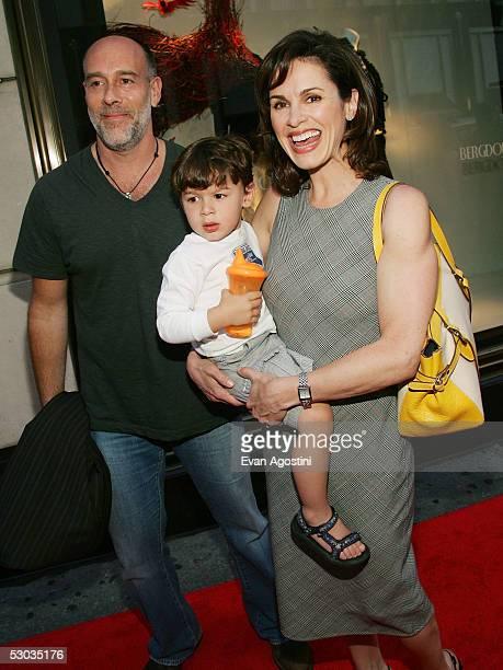 News anchor Elizabeth Vargas husband Marc Cohn and son Zachery arrive at a party for Madonna's new children's book 'Lotsa De Casha' at Bergdorf...