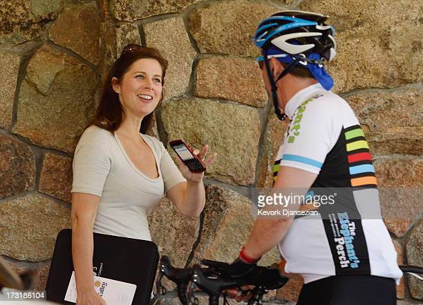 News anchor Erin Burnett, from CNN's OutFront, arrives for the Allen & Co. Annual conference at the Sun Valley Resort on July 9, 2013 in Sun Valley,...