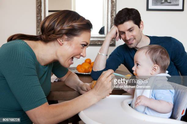 News anchor Ginger Zee husband/journalist Ben Aaron and son Adrian Benjamin are photographed for People Magazine on June 6 2016 in New York City...