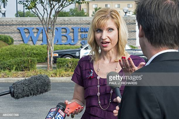 WDBJ news anchor Kimberly McBroom is interviewed at the gate of WDBJ's television studios August 27 in Roanoke Virginia The former television...